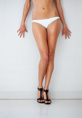 Buy stock photo Sexy young woman standing in bikini - Cropped imag