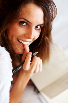 Buy stock photo Portrait of a lovely young woman writing a diary