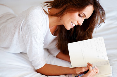 Buy stock photo Closeup of a relaxed young girl writing diary