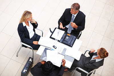 Top view: Sophisticated business people sitting in a meeting