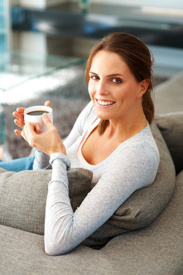 Buy stock photo Woman relaxing on couch with cup of coffee