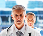 Senior medical doctor with colleague in the background