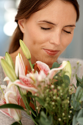 Buy stock photo Lovely young woman smelling bunch of flowers