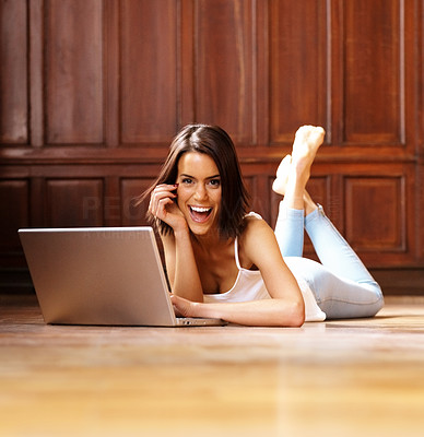 Buy stock photo Happy young woman working on laptop