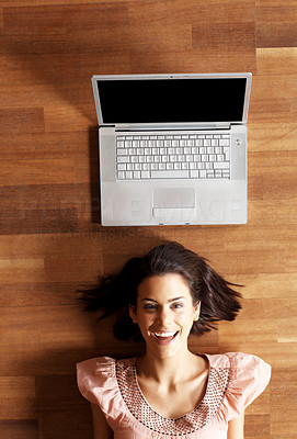 Buy stock photo Beautiful young woman relaxing on the floor with her laptop - copyspace