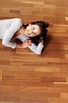 Cute young woman relaxing on the floor
