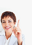 A cute business woman pointing upwards on white background
