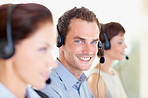 Young man working at a call centre
