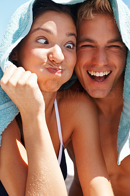Funny couple covering their head with a towel