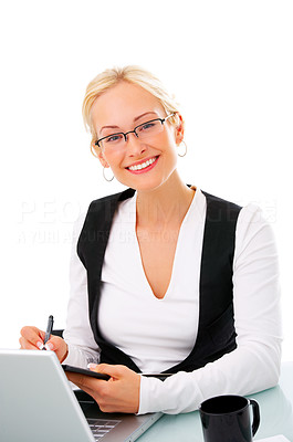 Buy stock photo Studio shot of a young businesswoman using a laptop isolated on white