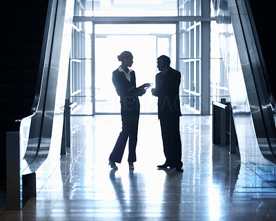 Silhouette image of business people standing together