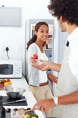 Cute young couple preparing food together at home