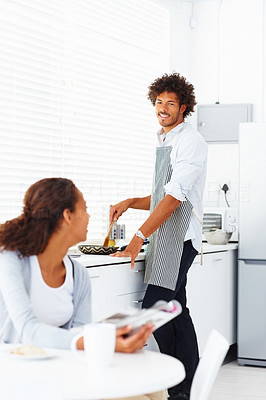 Young man preparing food for his wife at home