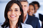 Blur image of a lovely happy businesswoman with her colleagues behind