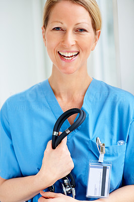 Confident successful happy doctor in uniform holding stethoscope
