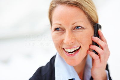 Cheerful elegant joyful business woman enjoying her conversation