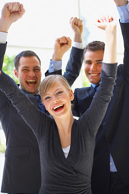 Buy stock photo Shot of a group of cheering businesspeople with their arms raised in the air