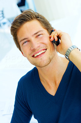 Buy stock photo IT executive laughing while talking on his cellula