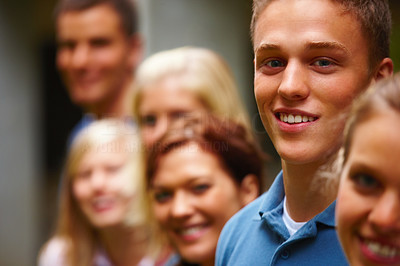 Line of smiling youth faces looking happy