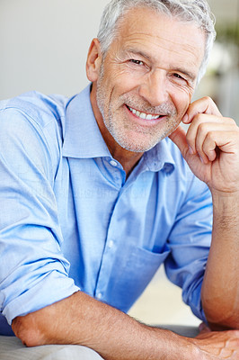 Buy stock photo Shot of a mature businessman looking happy