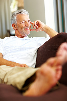 Buy stock photo Handsome mature man looking at something interesti