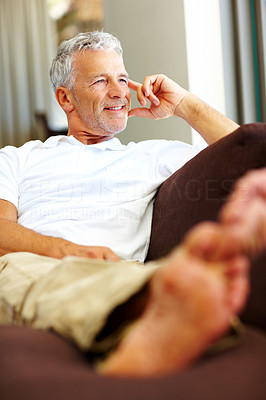 Buy stock photo Happy senior man thinking about something interest