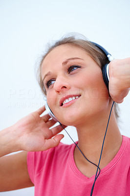 Woman listening to music isolated on white background
