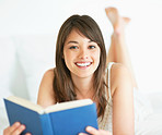 Charming young woman reading a novel