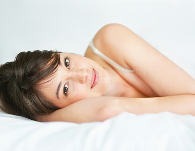 Buy stock photo Cute young woman relaxing on the bed