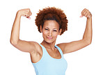 Fit young woman flexing her biceps against white
