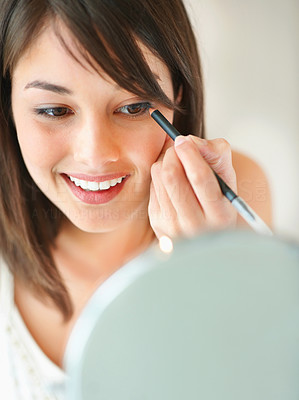 Buy stock photo Makeup - Young woman applying eye shadow