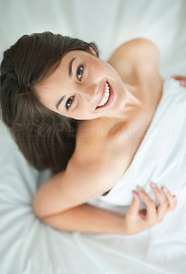 Buy stock photo Happy young woman relaxing on bed - Top view
