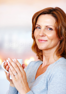 Buy stock photo Pretty young female enjoying a cup of coffee at ho