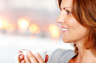 Buy stock photo A pretty young woman enjoying a cup of coffee at home
