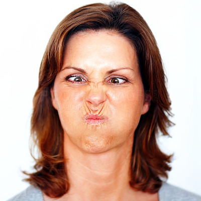Buy stock photo Young woman making a funny face over white