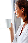 Pretty young woman drinking coffee - Indoor
