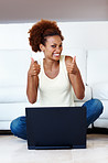 Woman with laptop sitting on floor
