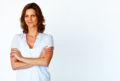 Buy stock photo Beautiful young woman standing with folded hand