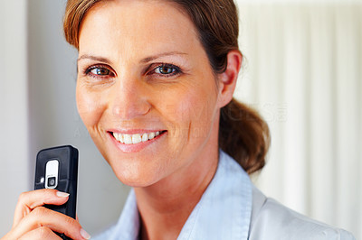 Buy stock photo Beautiful young woman with mobile phone