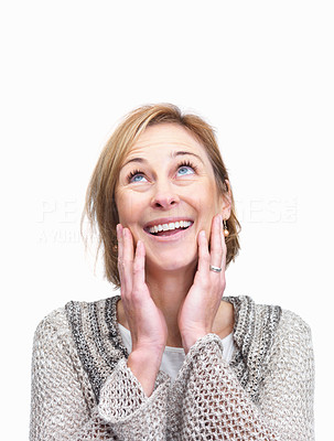 Buy stock photo Surprised middle aged woman looking upwards over w