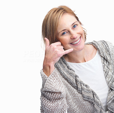 Buy stock photo Happy mature female gesturing a call me sign on wh