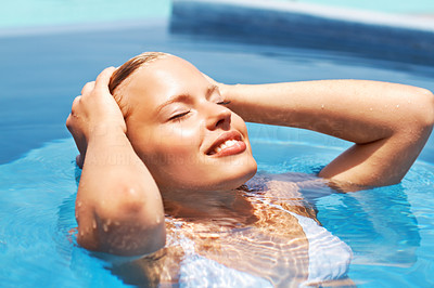 Happy young girl in water pool