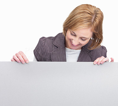 Buy stock photo Mature woman looking at billboard over white backg