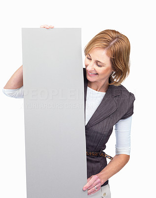 Buy stock photo Happy middle aged woman holding a blank billboard