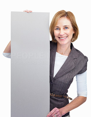 Buy stock photo Happy mature woman holding blank billboard over wh