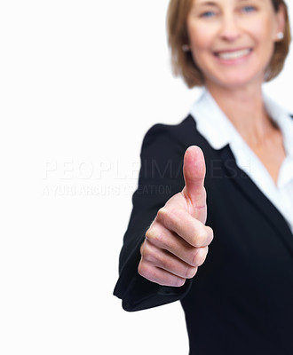 Buy stock photo Cut image of a mature business woman showing thumb