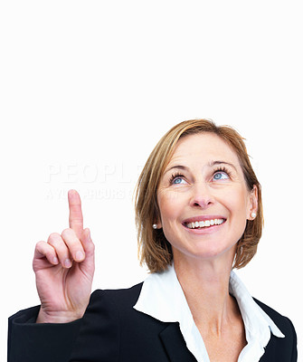 Buy stock photo Happy business woman pointing up at copyspace on w