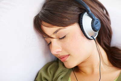 Buy stock photo Young female fallen asleep while listening to musi