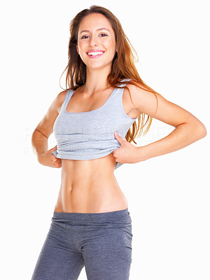 Buy stock photo Happy woman showing off her abs