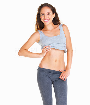 Buy stock photo Happy woman showing off her abs with hand on midsection